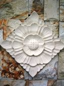 foto of garden sculpture  - A balinese flower art on the wall - JPG