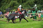 picture of jousting  - Stuntmen dressed as medieval knights jousting at a country show - JPG