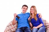 stock photo of coca-cola  - Young people sitting on a sofa and drinking Coca Cola - JPG