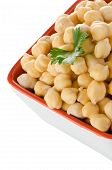 stock photo of bengal-gram  - Closeup of a bowl with boiled chickpeas on a white background - JPG