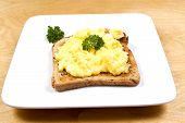 image of scrabble  - A plate of scrabbled egg decorated with sprigs of parsley - JPG