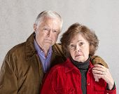 image of sulky  - Serious European man and woman holding hands - JPG