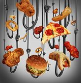 stock photo of hook  - Eating addiction health care concept with a group of metal fish hooks using fast food as human bait as fried chicken hamburgers and french fries as a symbol of the dangers of being hooked on sugar fat and salt - JPG