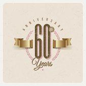 image of eyeleteer  - Vintage Anniversary type emblem with golden ribbon and decorative elements  - JPG