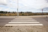image of pedestrian crossing  - Pedestrian crossing in abandoned housing estate building site - JPG