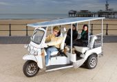 picture of rickshaw  - Solar powered tuc tuc at the beach picking up two young women - JPG