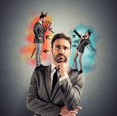 stock photo of hells angels  - Temptation of a businessman with angel and devil - JPG