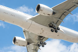 foto of noise pollution  - closeup of a large passenger aircraft undercarriage  - JPG