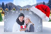 stock photo of quaint  - happy winter couple with gift against quaint town with bright moon - JPG