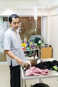 picture of veterinary surgery  - veterinarian care illness puppy in veterinary clinic  - JPG