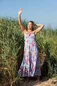 pic of minx  - Young woman with dreadlocks on nature background - JPG