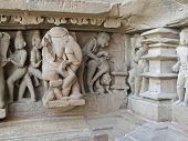picture of kama  - Sculptures of loving couples illustrating the Kama Sutra on walls of Varaha Temple Khajuraho in India Asia - JPG