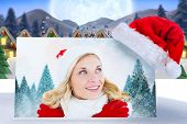 image of quaint  - happy festive blonde against quaint town with bright moon - JPG