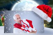 pic of quaint  - happy festive man with gifts against quaint town with bright moon - JPG