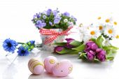 picture of paint pot  - blue campanula flowers in flower pot and easter painted eggs - JPG