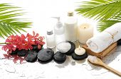 foto of wet  - Spa Background with palm and wet stones with pink orchid  - JPG