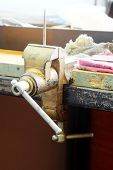 pic of workbench  - the image of a vice on a metal workbench - JPG