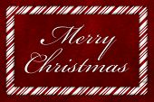 pic of candy cane border  - A Merry Christmas message A Candy Cane border with the words Merry Christmas over red plush background - JPG