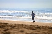 Jogger On The Beach poster