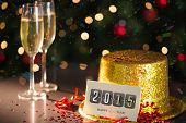 image of champagne color  - 2015 card on table set for party with gold hat and champagne - JPG
