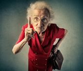 stock photo of grandma  - Angry grandma pointing out something  - JPG