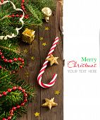 image of candy cane border  - Festive decorations with stars and candy cane on wood - JPG