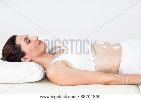poster of Woman having electrotherapy on white background