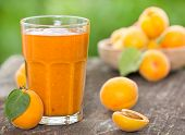 foto of apricot  - Fresh apricot and juice on the table - JPG