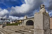 stock photo of manor  - Figures carved sphinxes of gray granite and are on the waterfront opposite the manor Kushelev - JPG