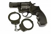 stock photo of guns  - gun and handcuffs - JPG