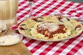 foto of glass noodles  - Italian pasta dinner served with Marinara sauce parmesan cheese over bow tie noodles accompanied by a glass of Chianti wine and bread - JPG