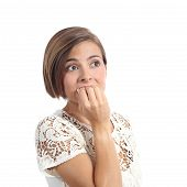 foto of horrifying  - Nervous worried woman biting nails isolated on a white background - JPG