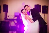 stock photo of night gown  - beautiful romantic first dance by wedding couple - JPG