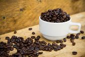 foto of coffee crop  - Coffee beans background on wooden - JPG