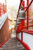 image of alloy  - row of alloy bell on the stairway in asian temple - JPG