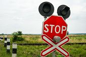 image of railroad-sign  - Traffic lights stops sign and crossbuck sign at the railroad crossing in Ukraine - JPG
