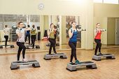 image of step aerobics  - Group of women making step aerobics in the fitness class - JPG