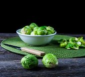 pic of brussels sprouts  - brussels sprouts on old wood table - JPG