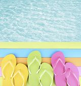 foto of beside  - Female flip flops on wooden platform beside sea - JPG