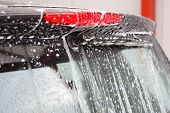 image of car wash  - rearwindow detail of a smart car at the carwash - JPG