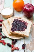 picture of home-made bread  - breakfast : home made bread with mulberry jam on wooden table ** Note: Shallow depth of field - JPG