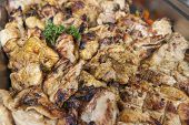 image of buffet  - Grilled chicken pieces on display at an oriental restaurant buffet