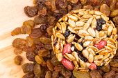 picture of baked raisin cookies  - Cookie with sunflower seeds lying on raisins - JPG