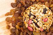 stock photo of baked raisin cookies  - Cookie with sunflower seeds lying on raisins - JPG