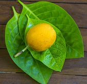 stock photo of passion fruit  - Passion fruits and Green Leaf on Wooden Background - JPG
