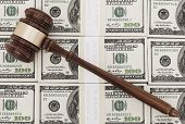 pic of 100 dollars dollar bill american paper money cash stack  - Wooden gavel on one hundrd dollar bills - JPG