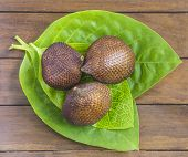 pic of green snake  - Snake Fruit and Green Leaf on the Wood Table - JPG