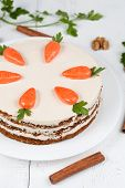 picture of carrot  - Easter homemade carrot cake with little carrots on top on white background - JPG
