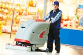 foto of washing machine  - Floor care and cleaning services with washing machine in supermarket shop store - JPG
