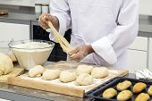 foto of pastry chef  - Baker kneading dough to make bread Bakery and food preparation - JPG